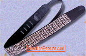 GUITAR STRAP - 4 ROW CHROME PYRAMIDS STUD ON B. LEATHER